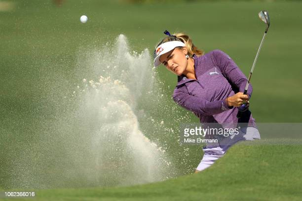 Lexi Thompson plays a shot from a bunker on the sixth hole during the second round of the CME Group Tour Championship at Tiburon Golf Club on...
