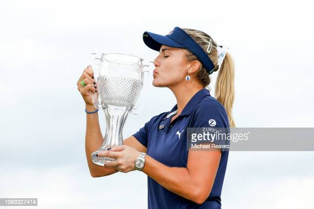Lexi Thompson poses for a photo with the CME Group Tour Championship trophy at Tiburon Golf Club on November 18 2018 in Naples Florida