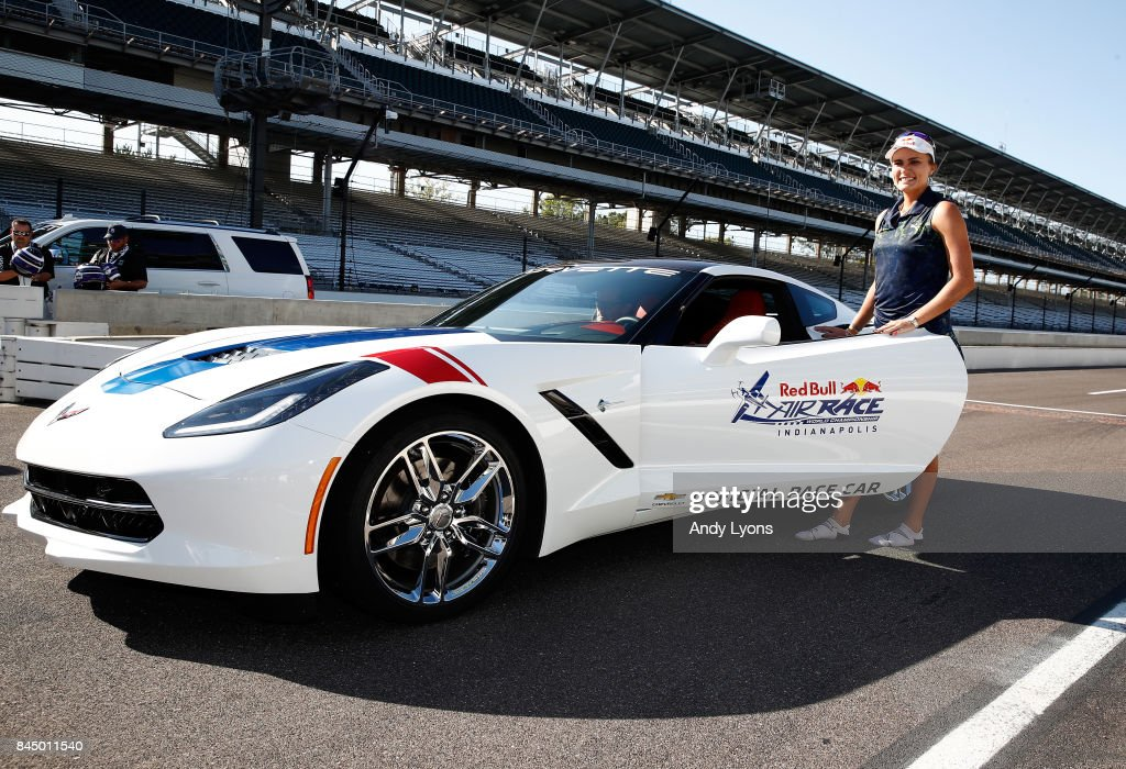 Lexi Thompson poses with a pace car that she was preparing to drive after winning the Indy Women In Tech Championship-Presented By Guggenheim at the Brickyard Crossing Golf Course on September 9, 2017 in Indianapolis, Indiana.