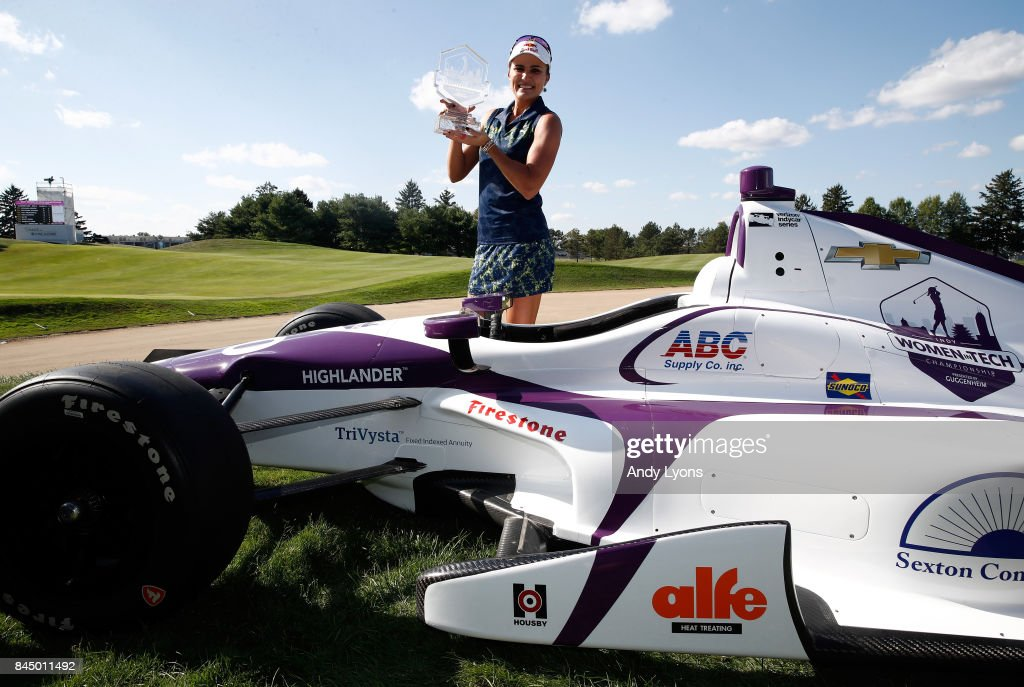 Lexi Thompson poses with a race car after winning the Indy Women In Tech Championship-Presented By Guggenheim at the Brickyard Crossing Golf Course on September 9, 2017 in Indianapolis, Indiana.