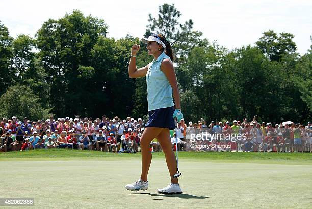 Lexi Thompson reacts after making a par putt on the 18th green to win the Meijer LPGA Classic presented by Kraft at Blythefield Country Club on July...