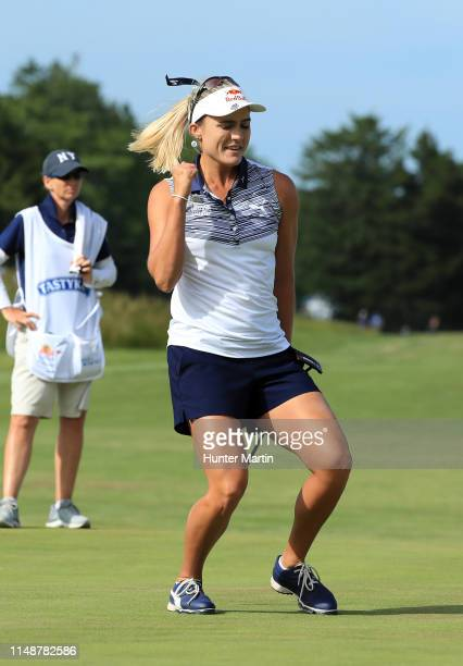 Lexi Thompson reacts after making her putt for eagle on the 18th hole during the final round of the ShopRite LPGA Classic presented by Acer on the...