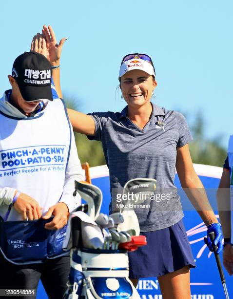 Lexi Thompson reacts to making a hole in one on the third hole during the first round of the Pelican Women's Championship at Pelican Golf Club on...