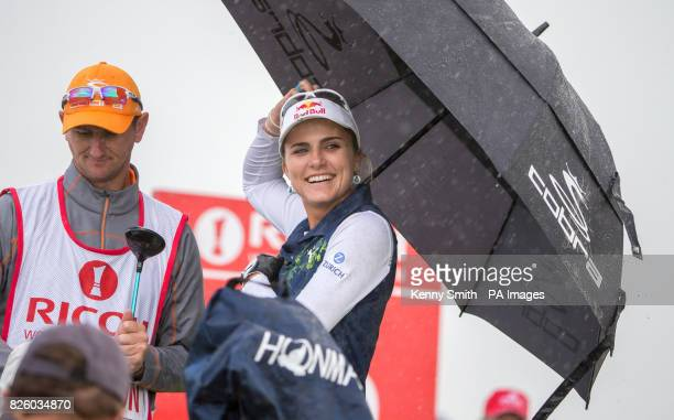 Lexi Thompson shelters from the downpour after she had teed off at the 16th hole during day one of the 2017 Ricoh Women's British Open at Kingsbarns...
