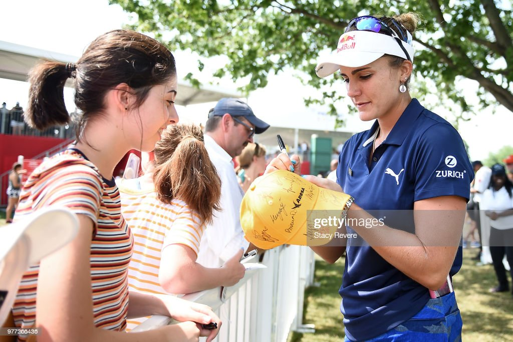 Lexi Thompson signs autographs for fans during the final round of the Meijer LPGA Classic for Simply Give at Blythefield Country Club on June 17, 2018 in Grand Rapids, Michigan.