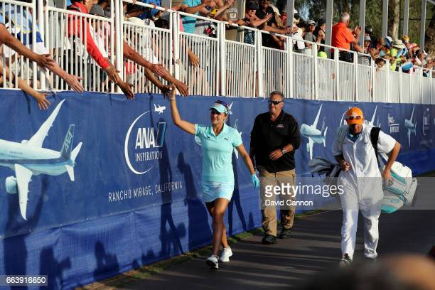Lexi Thompson walks to the green after her second shot on the 18th hole during the final round of the 2017 ANA Inspiration held on the Dinah Shore...