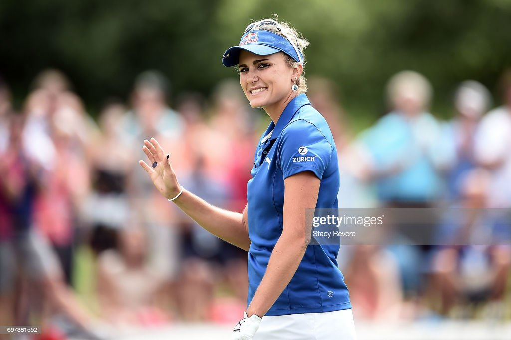 Lexi Thompson waves to the crowd as she approaches the 18th green during the final round of the Meijer LPGA Classic at Blythefield Country Club on June 18, 2017 in Grand Rapids, Michigan.
