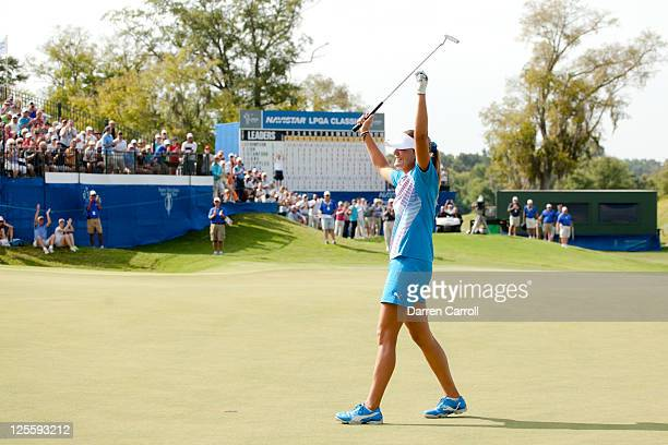 Lexi Thompsoncelebrates her victory at the 18th hole during the final round of the Navistar LPGA Classic at the Robert Trent Jones Golf Trail's...