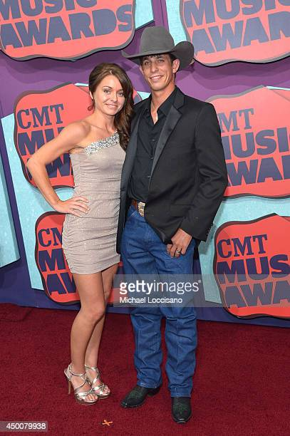 Lexi Wiggly and J B Mauney attend the 2014 CMT Music awards at the Bridgestone Arena on June 4 2014 in Nashville Tennessee