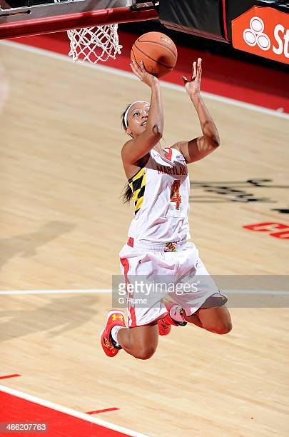 Lexie Brown of the Maryland Terrapins drives to the hoop against the Delaware State Hornets at the Comcast Center on December 14 2013 in College Park...