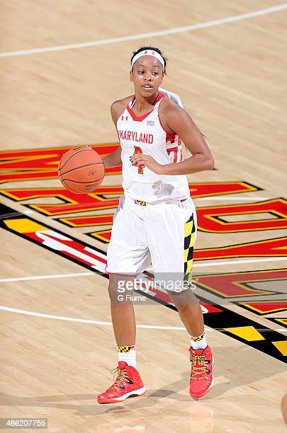 Lexie Brown of the Maryland Terrapins handles the ball against the Delaware State Hornets at the Comcast Center on December 14 2013 in College Park...