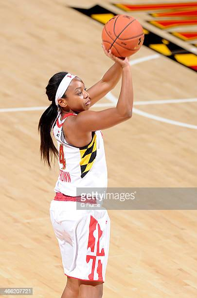 Lexie Brown of the Maryland Terrapins shoots the ball against the Delaware State Hornets at the Comcast Center on December 14 2013 in College Park...