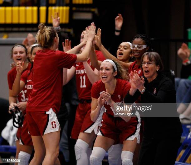 Lexie Hull of the Stanford Cardinal celebrates with the Head Coach Tara VanDerveer during a game against the Mississippi State Bulldogs at the...