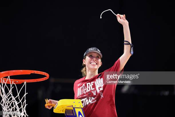 Lexie Hull of the Stanford Cardinal cuts the net after defeating the Louisville Cardinals in the Elite Eight round of the NCAA Women's Basketball...