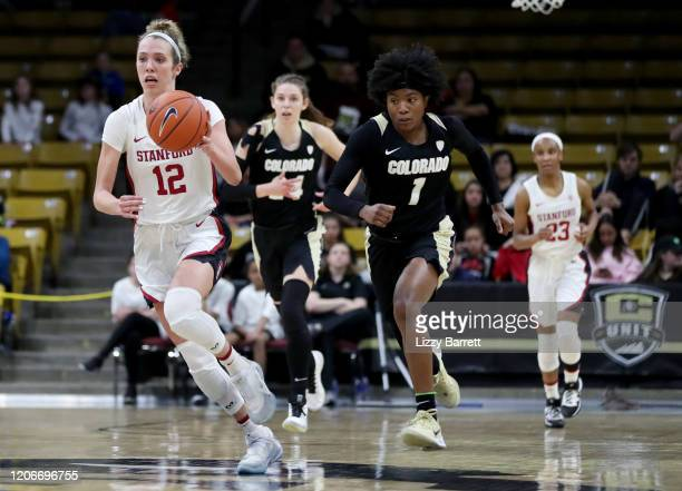 Lexie Hull of the Stanford Cardinal dribbles down court on a break away in front of Jaylyn Sherrod of the Colorado Buffaloes during the second...