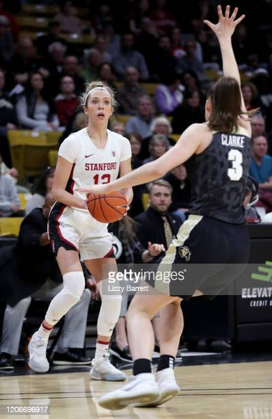 Lexie Hull of the Stanford Cardinal looks to move past the defense of Emma Clarke of the Colorado Buffaloes during the first quarter of a game...
