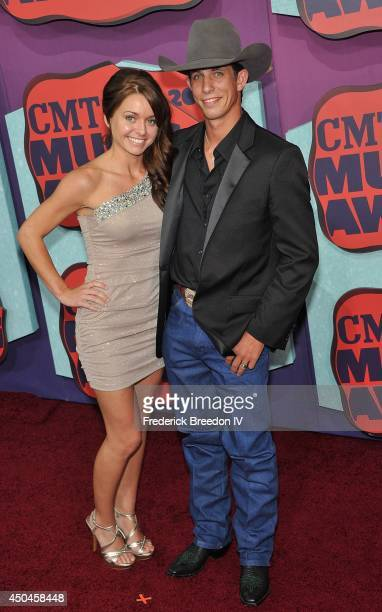 Lexie Wiggly and husband JB Mauney attend the red carpet at the 2014 CMT Music awards at the Bridgestone Arena on June 4 2014 in Nashville Tennessee