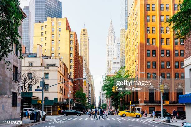 lexington avenue and chrysler building in new york city, usa - new york city stockfoto's en -beelden