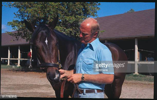 Kentucky Derby favorite Honest Pleasure shown here with trainer LeRoy Jolley goes to the post in the $100000 Blue Grass Stakes at Keeneland April 22...