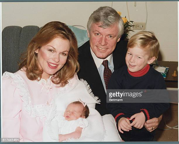 Phyllis George Brown and her husband Governor of Kentucky John Y Brown Jr and their son Lincoln admire the new addition to their family Pamela Ashley...