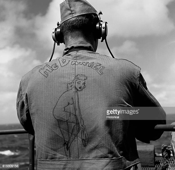 USS Lexington Marine Pfc Elmer McDaniel drew a 'Jawja' peach on his work jumper November 1943