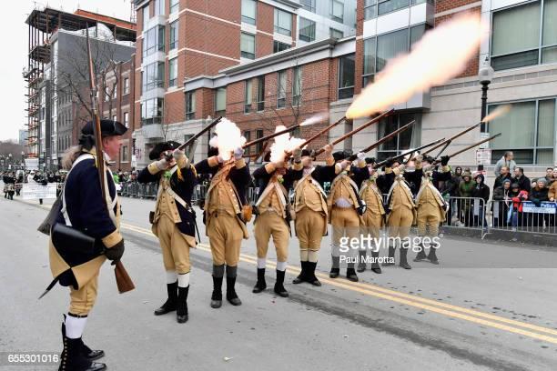 Lexington Minutemen Revolutionary War reeneactors participate in the St Patrick's Day Parade on March 19 2017 in Boston Massachusetts
