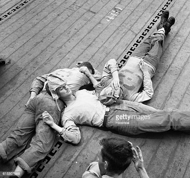 USS Lexington sailors asleep on the flight deck November 1943 | Location USS Lexington