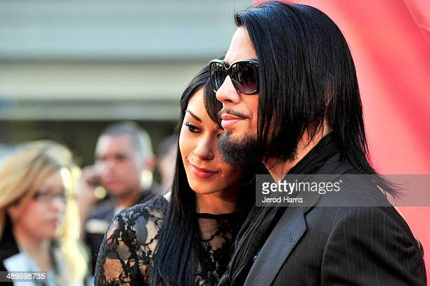 Lexus Amanda and Dave Navarro arrive at the 2014 MusiCares MAP Fund Benefit Concert at Club Nokia on May 12 2014 in Los Angeles California