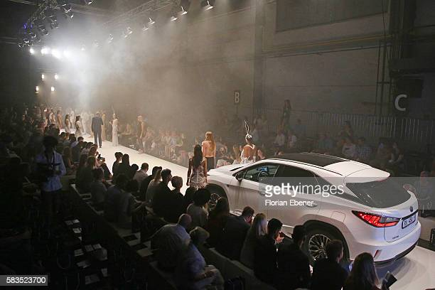 Lexus car and models are seen on the runway after the 3D Fashion Presented By Lexus show during Platform Fashion July 2016 at Areal Boehler on July...