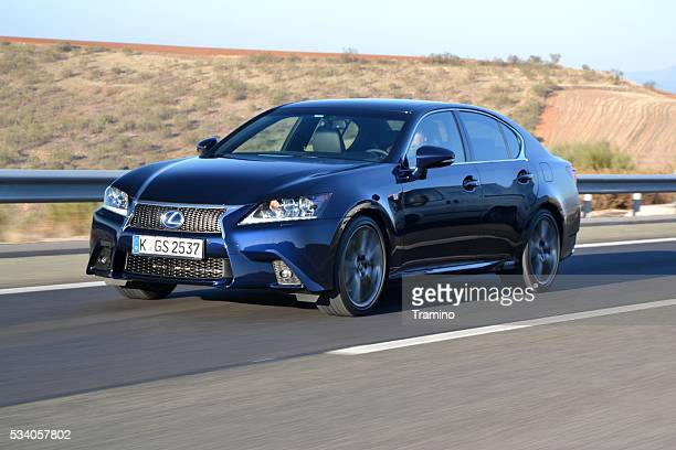 lexus gs300h on the highway - hybrid vehicle stock photos and pictures