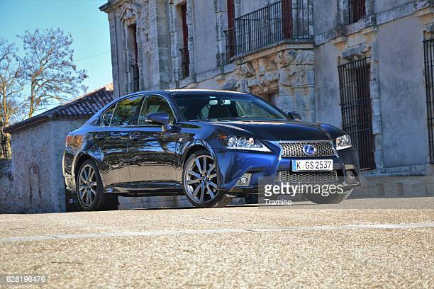lexus gs300h on the street - hybrid vehicle stock photos and pictures