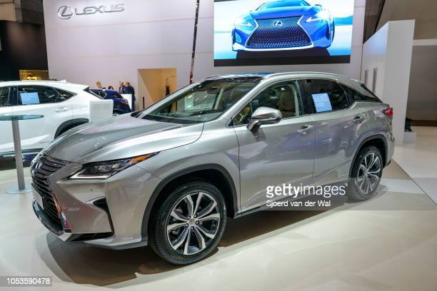 Lexus RX450h hybrid SUV three quarter front view on display at Brussels Expo on January 13, 2017 in Brussels, Belgium. The LX450h is fitted with a...