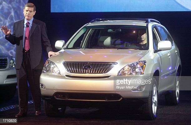 Lexus Vice President and General Manager Denny Clements shows the new 2004 Lexus RX 330 luxury SUV during a press conference at the North America...