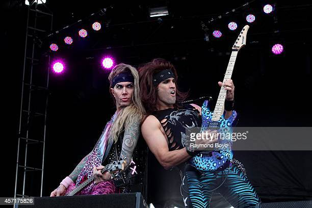 Lexxi Foxx and Satchel from Steel Panther performs during the 'Louder Than Life' Music Festival in Champions Park on October 04 2014 in Louisville...