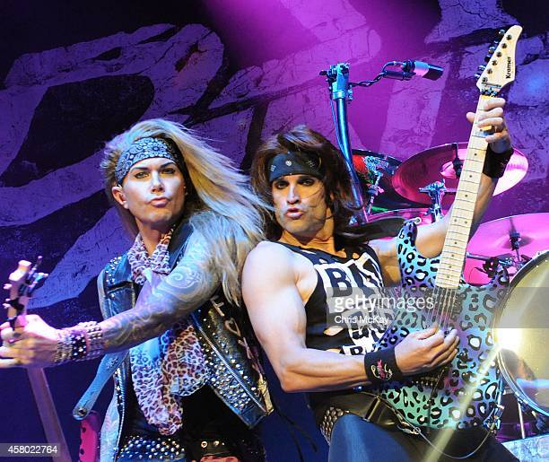 Lexxi Foxx and Satchel of Steel Panther perform at Arena at Gwinnett Center on October 28 2014 in Duluth Georgia