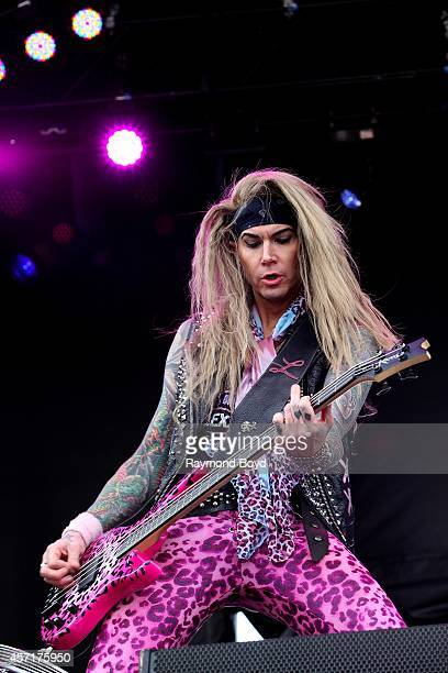 Lexxi Foxx from Steel Panther performs during the 'Louder Than Life' Music Festival in Champions Park on October 04 2014 in Louisville Kentucky