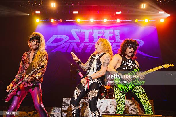 Lexxi Foxx Michael Starr and Satchel of Steel Panther perform at Manchester Arena on October 18 2016 in Manchester England