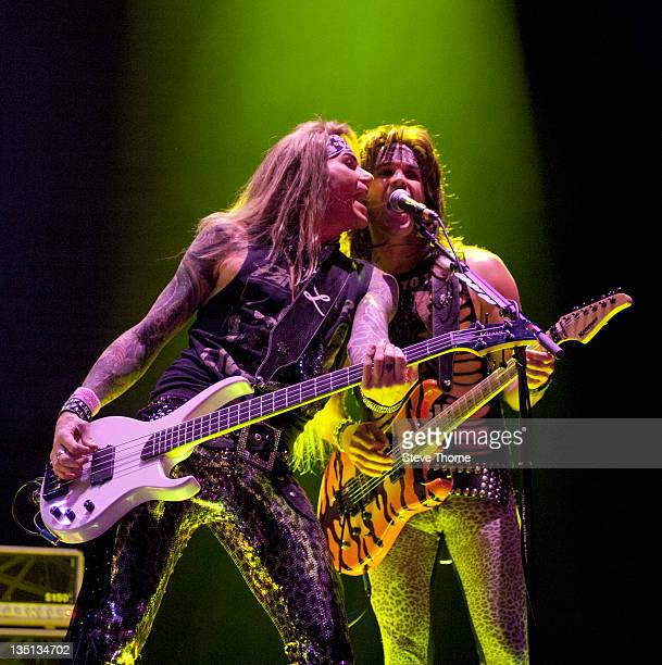Lexxi Foxxx and Satchel of Steel Panther perform on stage at LG Arena on December 6, 2011 in Birmingham, United Kingdom.