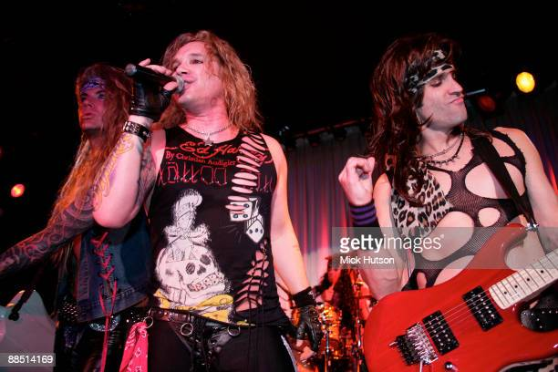 Lexxi Foxxx Michael Starr and Satchel of Steel Panther perform on stage at the Canal Room on April 1st 2009 in New York