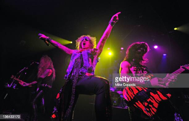 Lexxi Foxxx Michael Starr and Satchel of the rock band Steel Panther perform at Irving Plaza on January 4 2012 in New York City