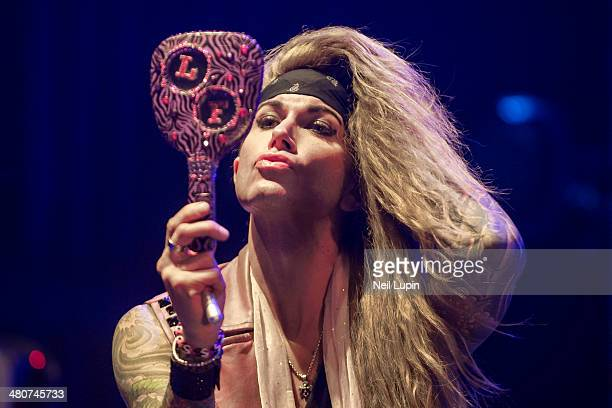 Lexxi Foxxx of Steel Panther performs on stage at Brixton Academy on March 26 2014 in London United Kingdom