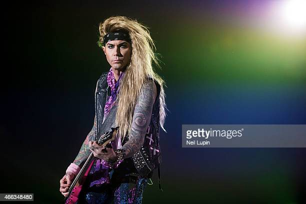 Lexxi Foxxx of Steel Panther performs on stage at Wembley Arena on March 14 2015 in London United Kingdom
