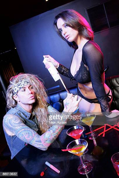 Lexxi Foxxx of Steel Panther poses with model hiarspray and cocktails at the Canal Room on April 1st 2009 in New York