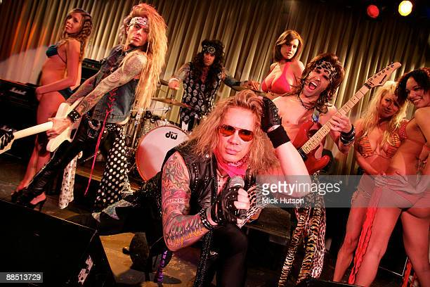 Lexxi Foxxx Stix Zadinia Michael Starr and Satchel of Steel Panther pose on stage with models at the Canal Room on April 1st 2009 in New York