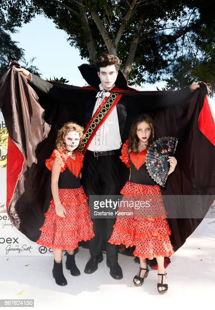 Lexy Kolker and Ava Kolker with Dracula at the Cybex by Jeremy Scott Cherub Halloween Launch Celebration on October 28 2017 in Los Angeles California