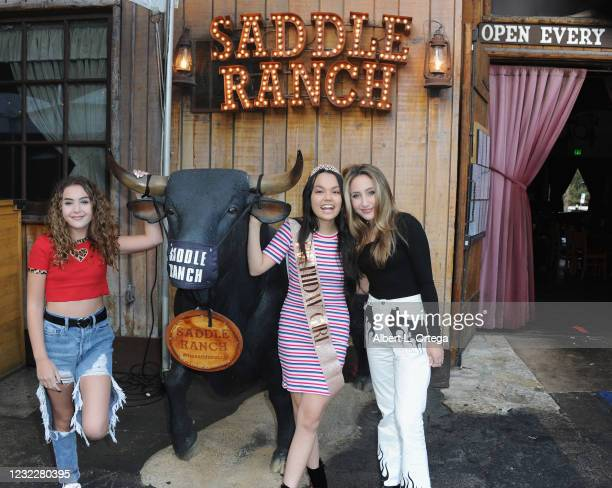 Lexy Kolker, Chalet Lizette Brannan and Ava Kolker attend Brannan's Sweet 16 Birthday Party at Saddle Ranch Chop House on April 12, 2021 in West...