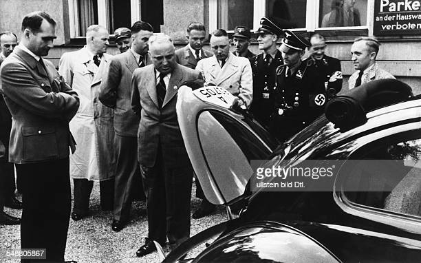 Ley, Robert - Politician, NSDAP, Germany *15.02.1890-+ - is handing off a Volkswagen to Rudolf Hess in front of the Brown House in Munich - August...