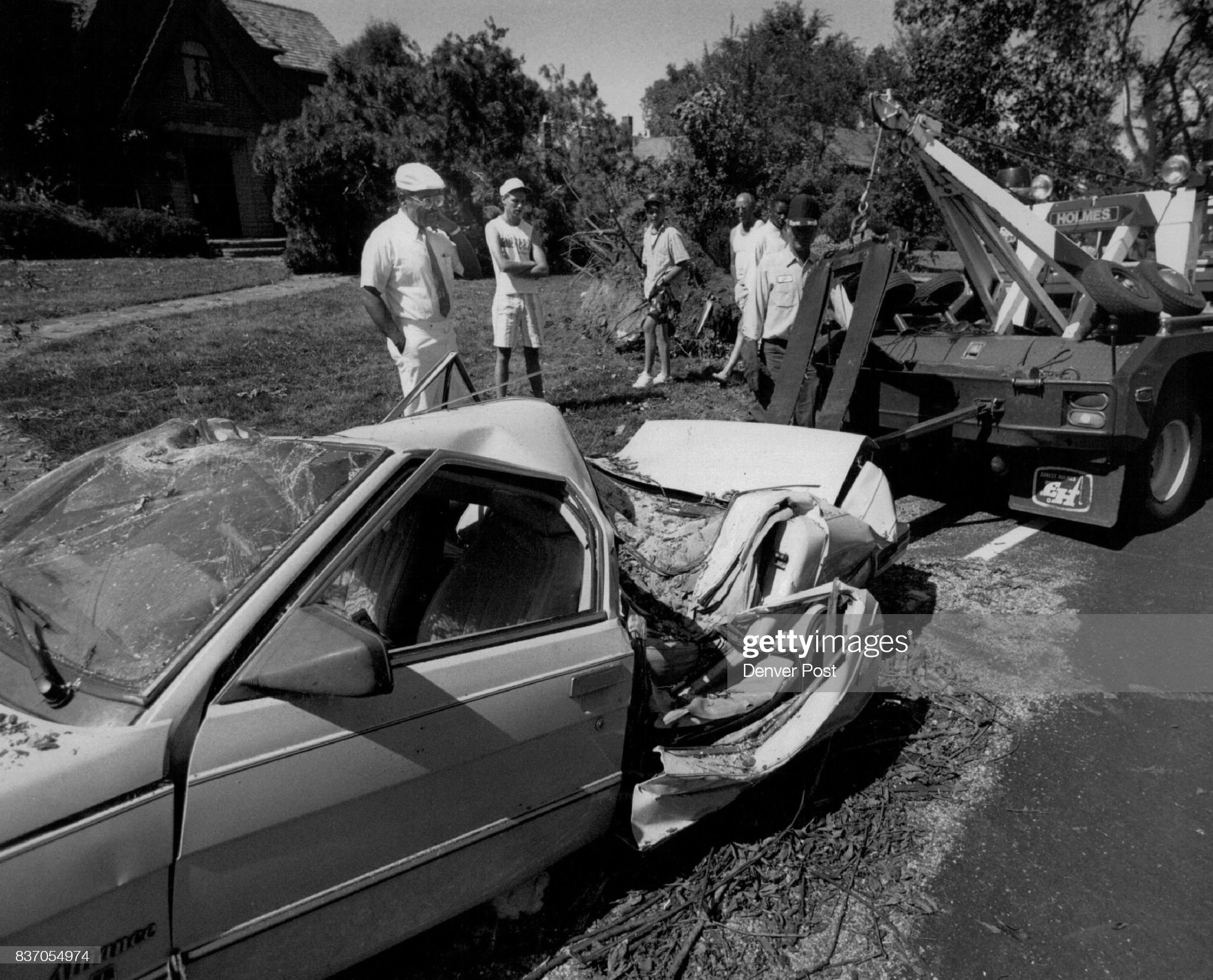 https://media.gettyimages.com/photos/leyden-and-monteciew-tonnado-aftermath-willie-white-looks-at-the-car-picture-id837054974?s=2048x2048