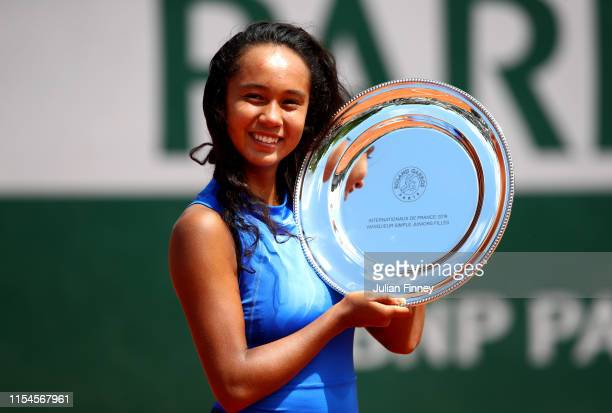 Leylah Annie Fernandez of Canada celebrates victory with the trophy during the girls juniors singles final against Emma Navarro of The United States...