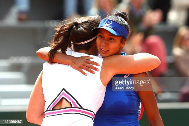 Leylah Annie Fernandez of Canada embraces Emma Navarro of The United States following their girls juniors final during Day fourteen of the 2019...